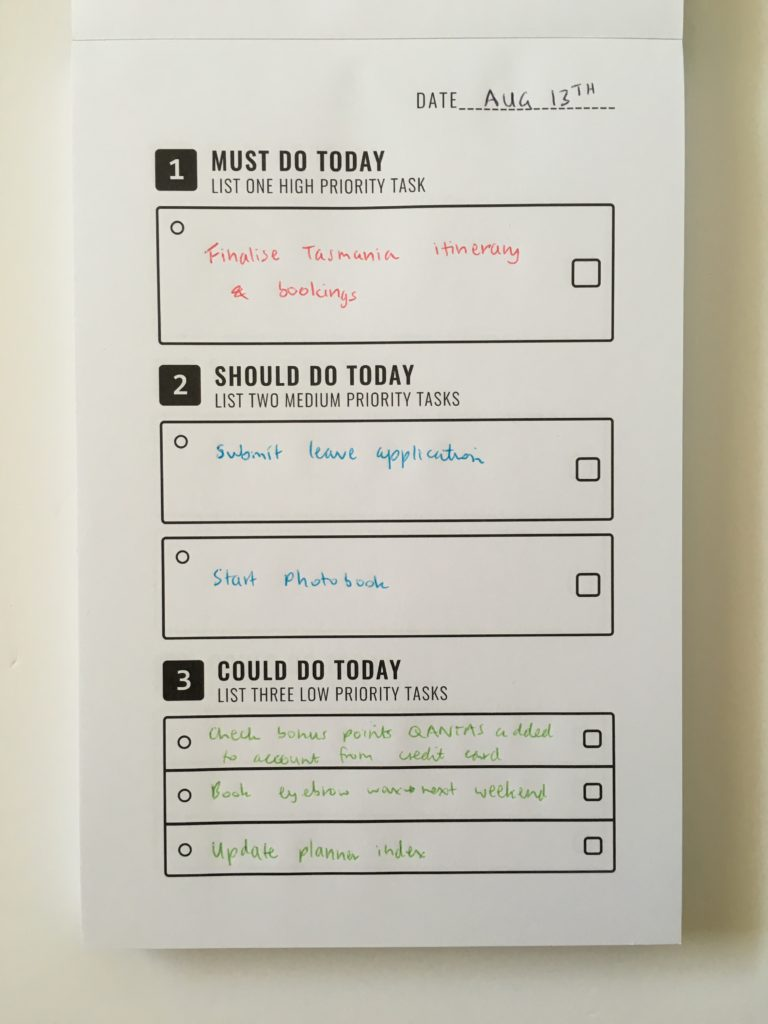 to do list in a book review notepad simple daily planner must do should do could do neutral priorities