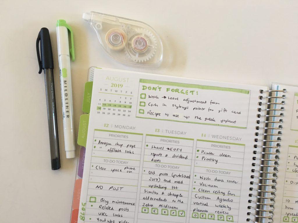 simple planner spread in plum paper vertical priorities ideas green black grey theme
