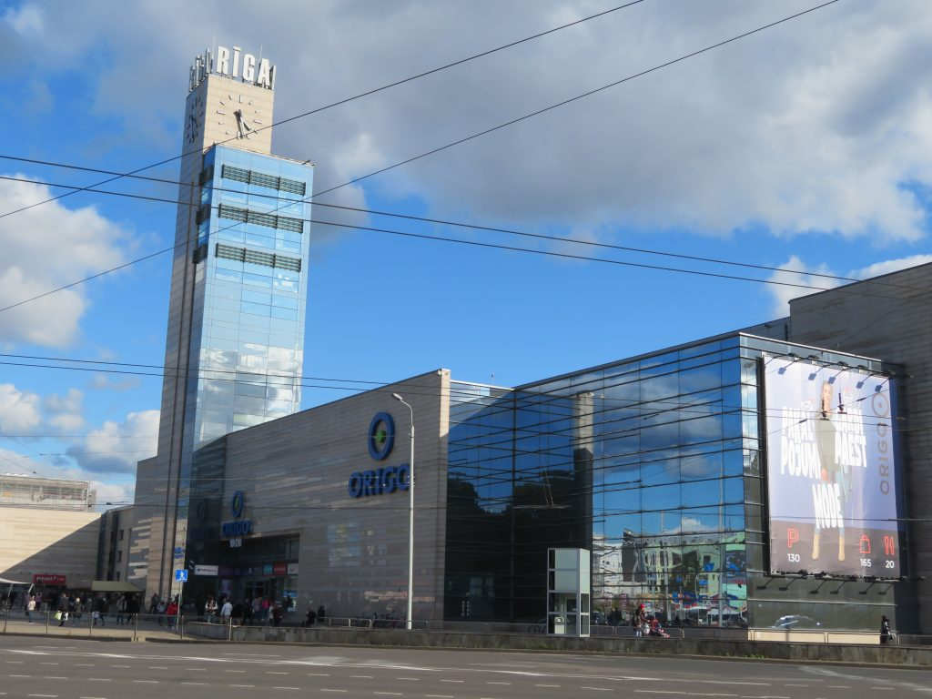 riga latvia guide for visiting best photo spots, riga clock near the lux bus station stockmann shopping centre riga central market walking photo spot itinerary
