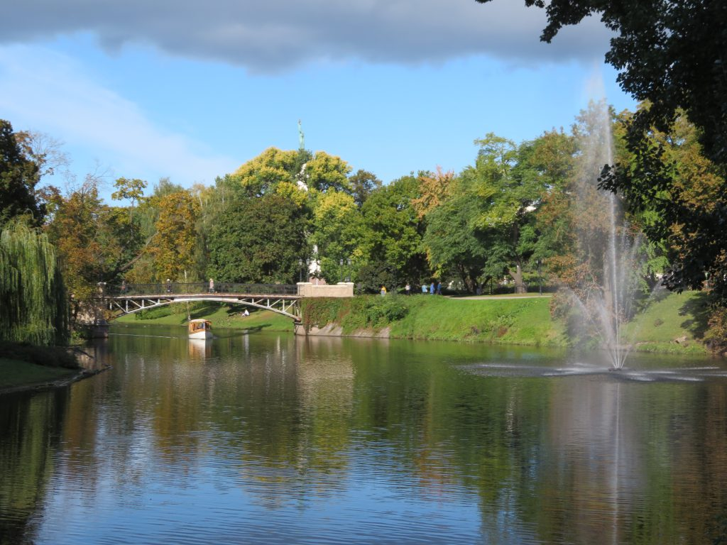 park behind the Freedom Monument in Riga, latvia autumn things to see and do best photospots walking tour