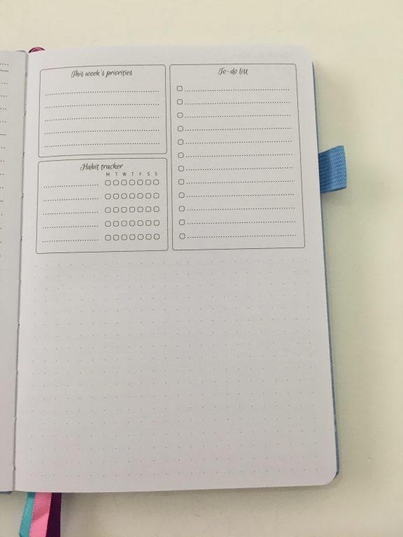 go girl planner review undated weekly monthly sewn bound horizontal lined goals habit tracker checklist bright white paper rainbow stickers pocket folder minimalist_16