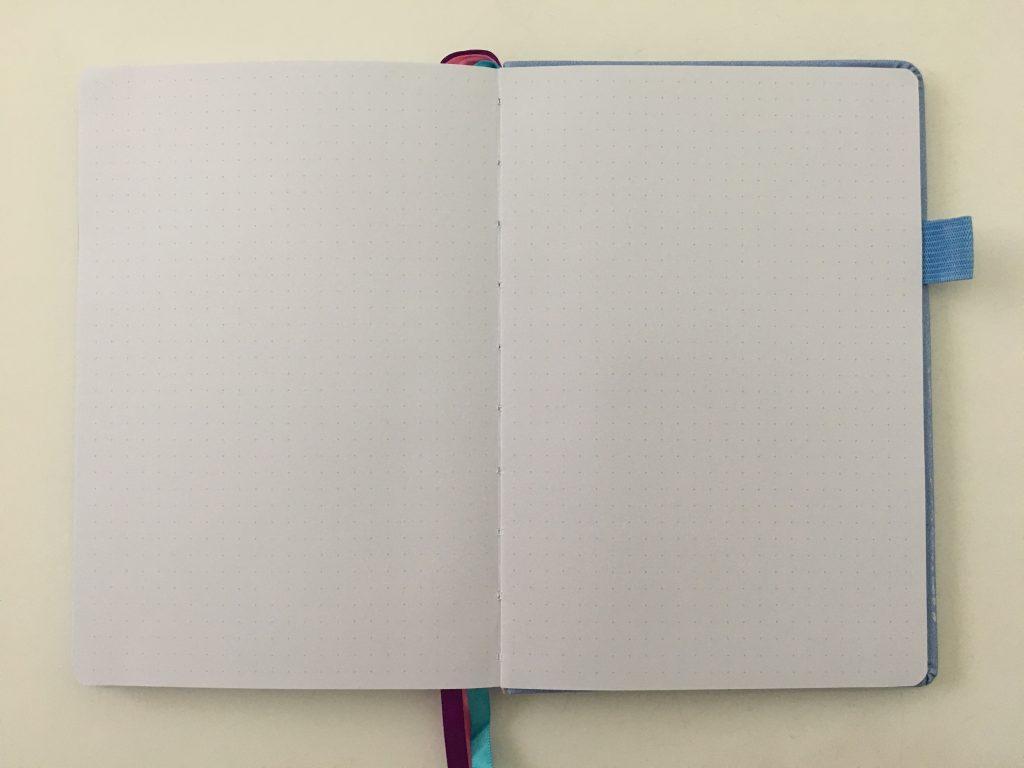 go girl planner review undated weekly monthly sewn bound horizontal lined goals habit tracker checklist bright white paper rainbow stickers pocket folder minimalist_17