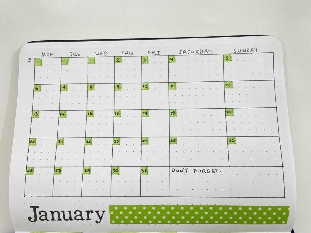 one page monthly calendar bullet journal green theme washi tape highlighters monday week start simple larger weekend otto dot journal australia-min