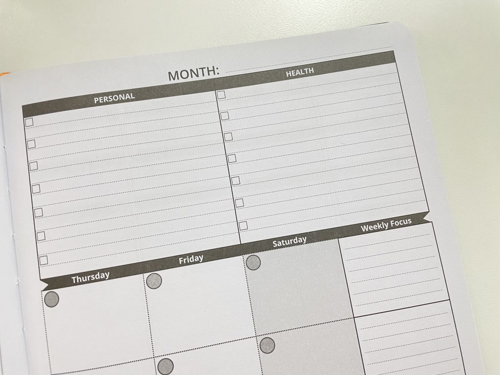 ignited life planner review 2 page monthly calendar lined undated weekly focus manage personal goals health work financial
